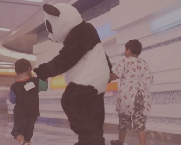 Panda with Children - Panda Cares brings hope to youth in need